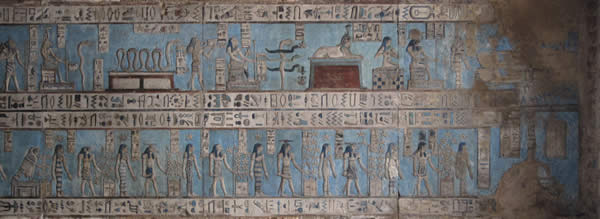 a hieroglyphic series of Egyptian figures performing acts of worship
