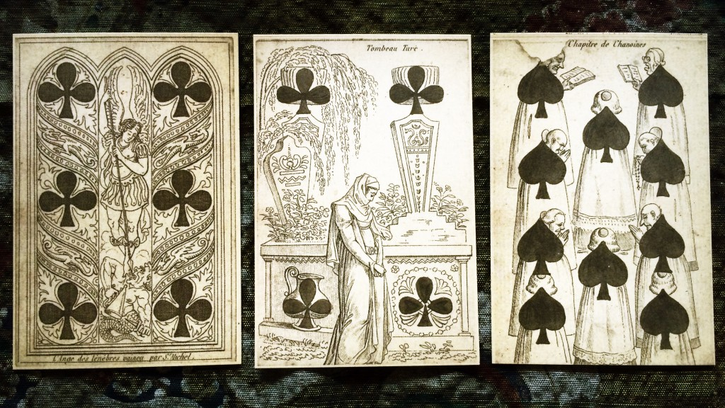 three cards, the six and four of clubs and the nine of spades, side by side on a table