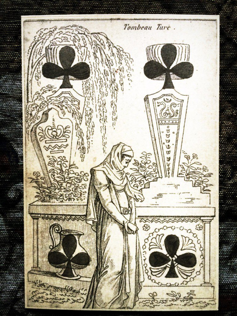 a detailed photograph of the four of clubs