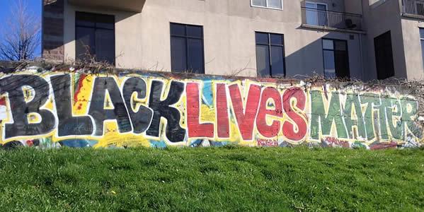 "street art depicting the phrase ""Black Lives Matter"""