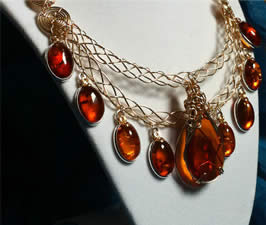 A handmade necklace of amber, goldfilled wire, goldfilled chain, sterling silver