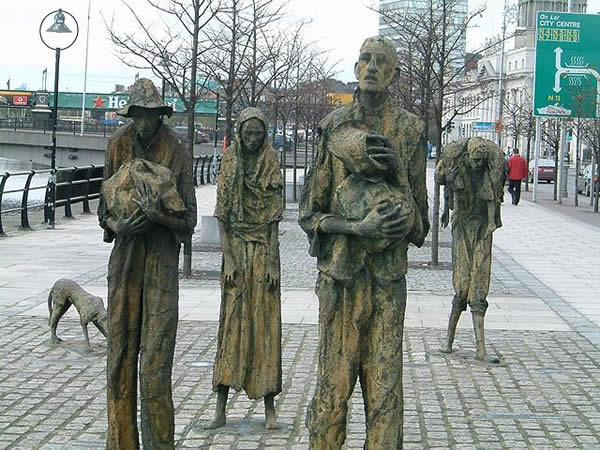 statues of four people gaunt with hunger