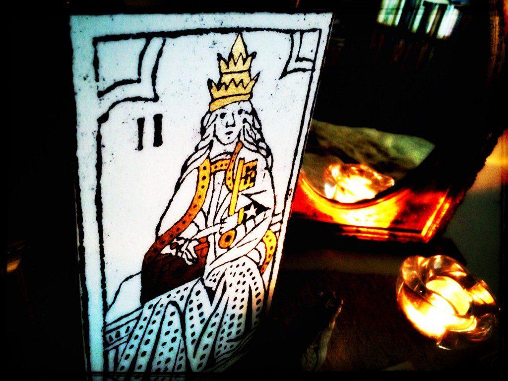 a tarot card, the Empress, on a table