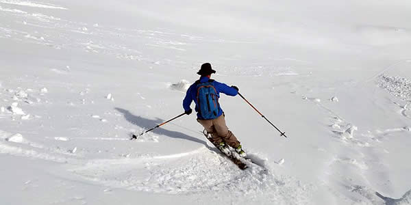 a man downhill skiing