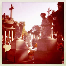 a filtered image of a cemetery made to look as if it was taking in the 19th century