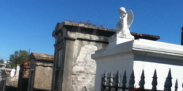 above ground tombs, common in New Orleans, under a blue sky