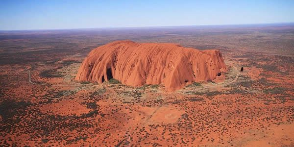 an aireal photograph of Uluru in Australia