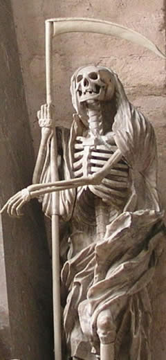 a statue of a skeleton holding a scythe