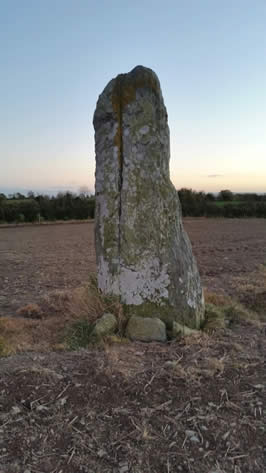 a solitary standing stone split down the middle
