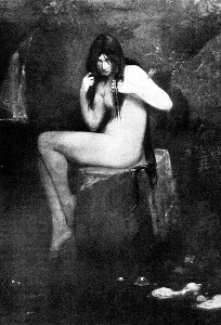 a seated naked woman peering through the bangs of her long hair