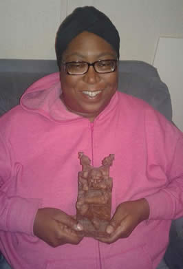 an african american woman holding a statue of loki