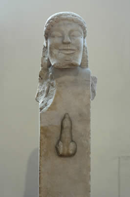 a sculture of Hermes's face on a rectangular base which includes an erect penis