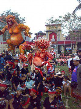 a celebration including a large ogoh-ogoh