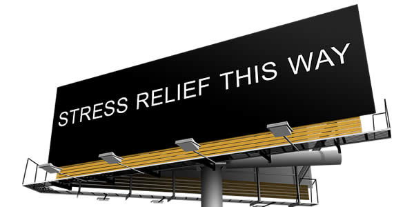 "a billboard reading ""stress relief this way"""