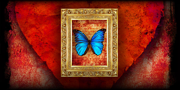 a blue butterfly framed in gold on a field of red