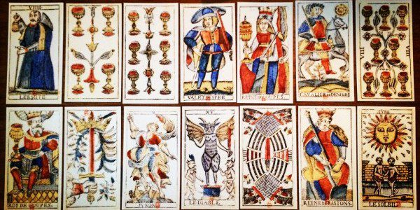 a tarot spread displaying fourteen different cards in two rows of seven