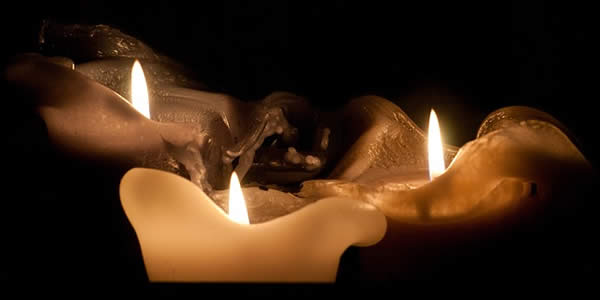 a photograph of three lit candles