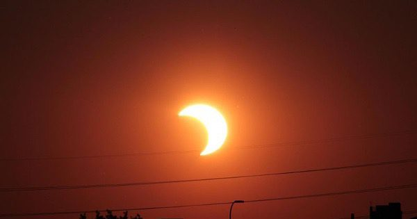 Partial Solar Eclipse, photo by Tomruen, From WikiMedia.  Public Domain Image.