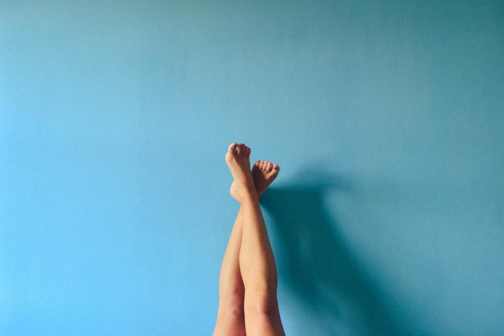 legs on blue background