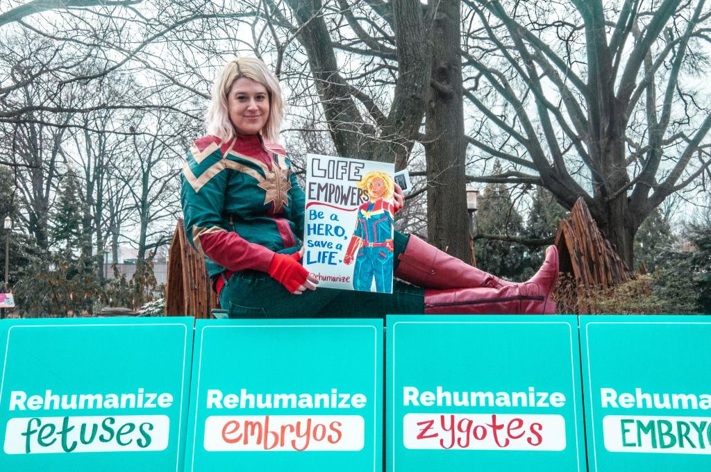woman in superhero costume protesting abortion