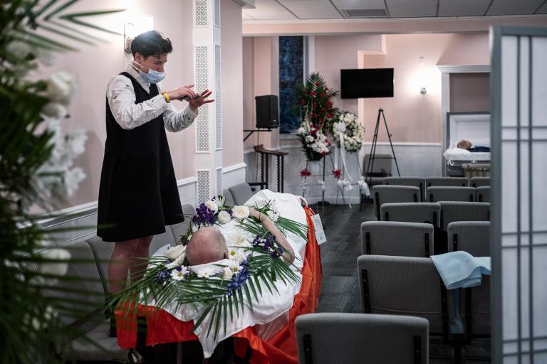 A funeral director calls relatives of a COVID-19 victim for a virtual viewing before cremation on May 22, 2020 in New York City.