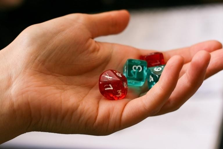 I like to throw dice with my hand.