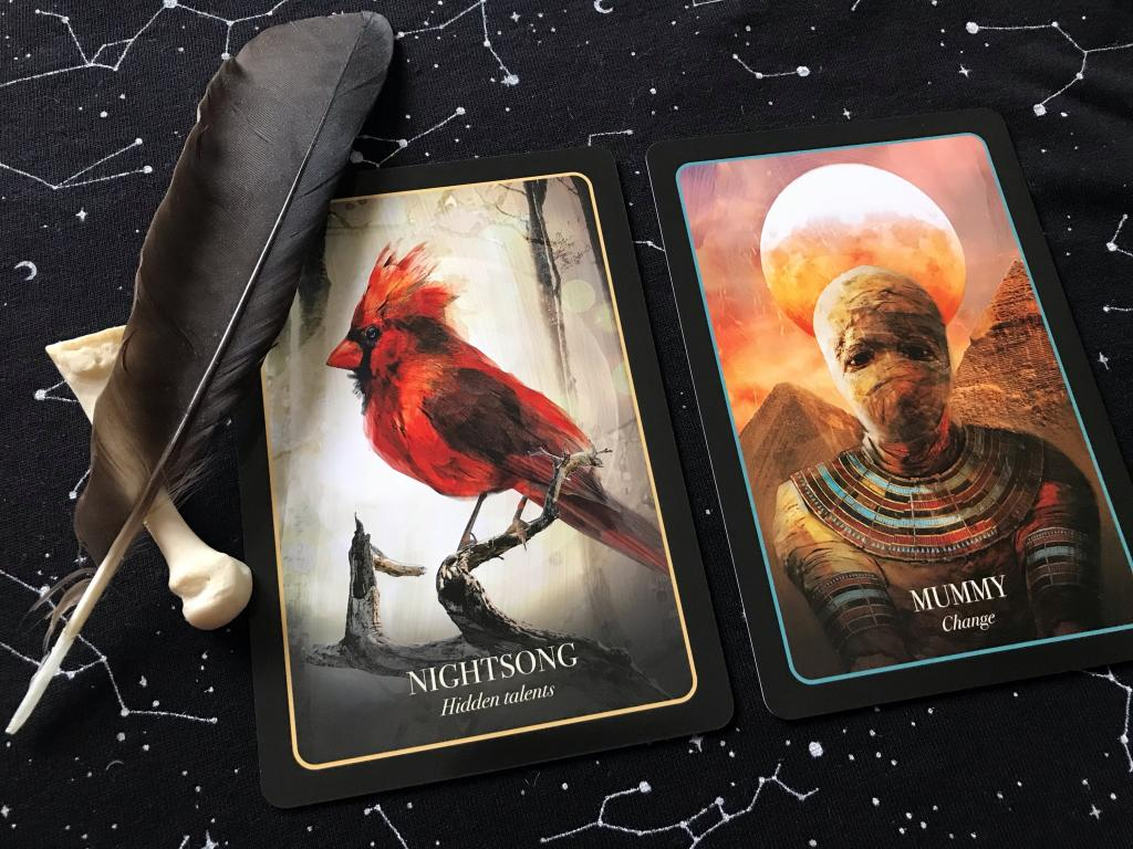 """Nightsong"" and ""The Mummy,"" two of the more anachronistic cards from The Halloween Oracle"