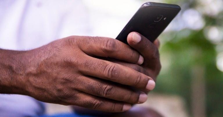 Hands holding a smartphone.
