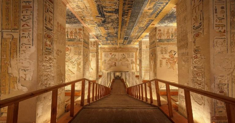 Ancient Egyptian tomb with a large, descending staircase.