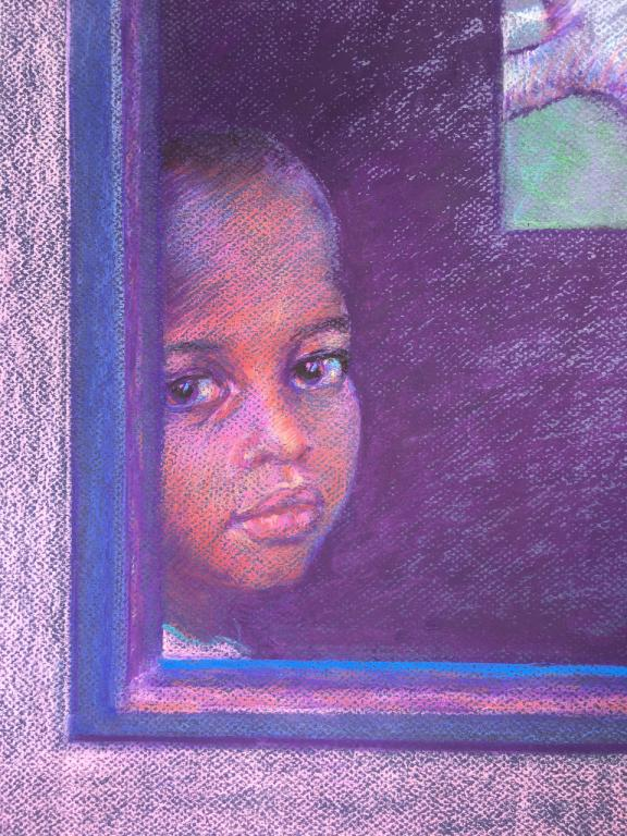 Mozambican child looking out the window