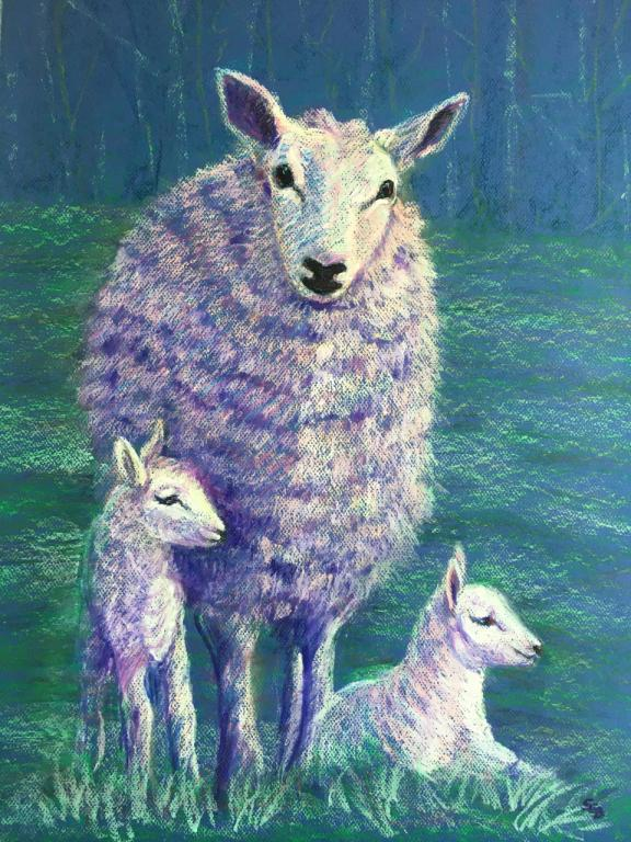 A mother sheep and two lambs.