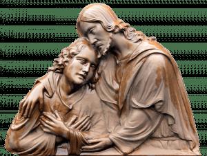 statue of Jesus hugging child