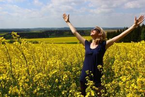 joyful woman in field of flowers