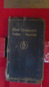 A copy of the New Testament used by Lieut. Funchess and Fr. Kapaun in the POW camp. Funchess explained that it had been taken from him several times; but each time, he was able to steal it back from his captors.