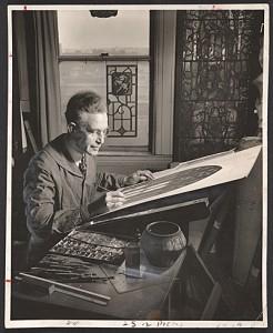 Wilbur Burnham designing a stained glass window