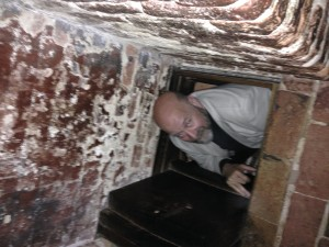 Padre clambering into the priest's hole