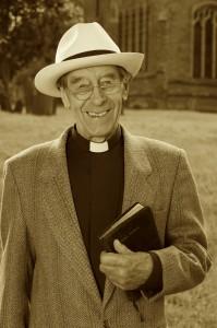 A vicar outside his church