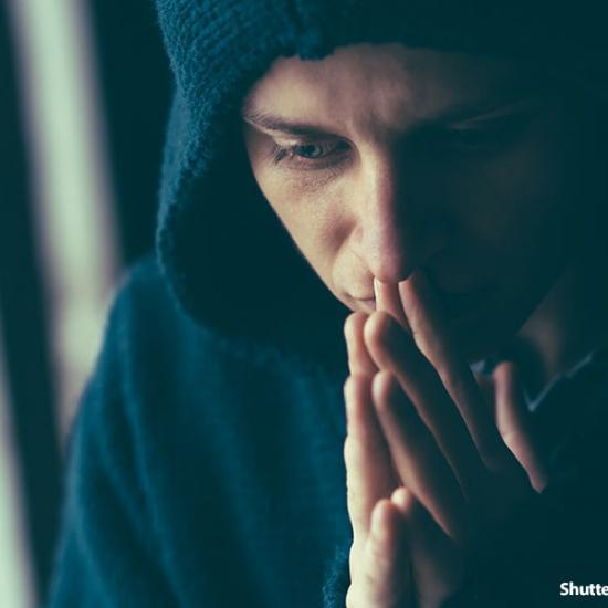 man-sad-praying