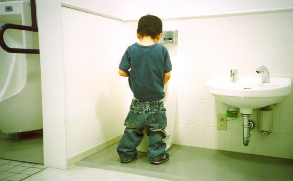 How do males pee standing up