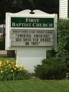 """America"" on church sign in Osage, Iowa"
