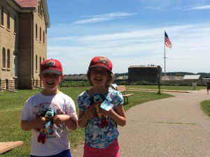 "The kids holding their ""History Hounds"" at Fort Snelling"