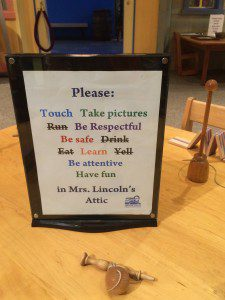 Sign at the Lincoln Museum encouraging kids to play with 19th century toys