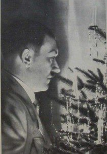 Image of Hitler looking at a Christmas tree