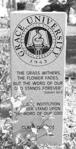 Dedication stone in the courtyard of Grace University (NE)