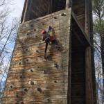Lena partway up the climbing wall