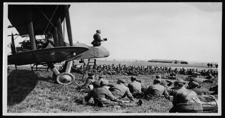 British chaplain preaching from an airplane cockpit in 1918
