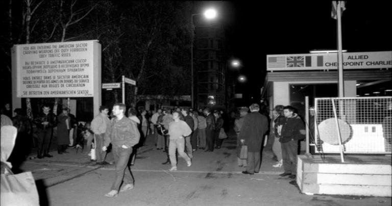 East Berliners walk through Checkpoint Charlie the night of Nov. 9-10, 1989