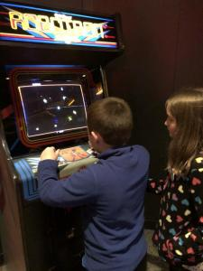 Isaiah playing the 1982 arcade game Robotron