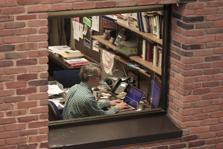 Chris Gehrz working in his office at Bethel University