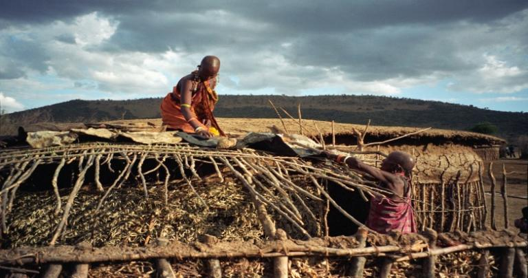 Maasai women repairing a roof